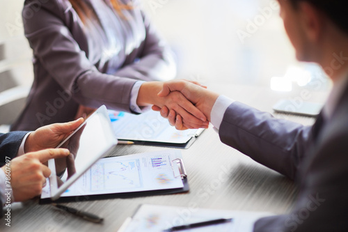 Business people shaking hands poster