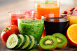 Glasses of fresh organic vegetable and fruit juices - 78609218