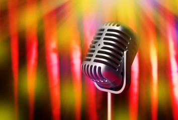 Retro microphone on bright curtain background