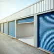 Empty storage unit with opened door - 78610224