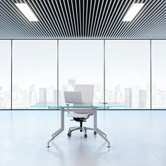 Modern workplace in the office with windows
