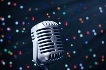 Retro microphone on bright background, Karaoke concept
