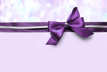 Color satin ribbon bow on bright background