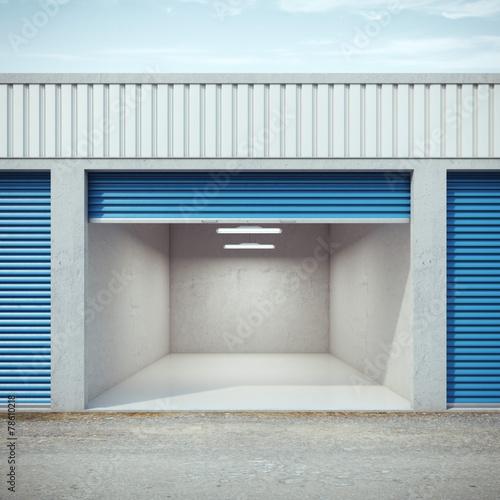 Fotobehang Industrial geb. Empty storage unit with opened door