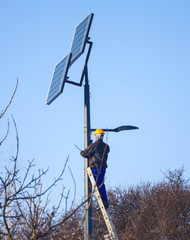 Male engineer at work place, solar collector