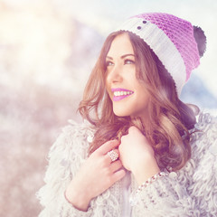 Beautiful young woman in soft colors outdoors in winter