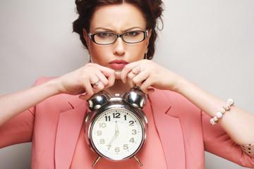 fun businesswoman with alarmclock