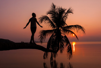 Girl standing on the palm over water