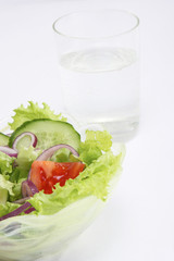 healthy food: a bowl with fresh salad, a glass of water on a