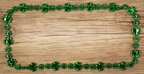 St. Patrick's Day. Frame on wooden background
