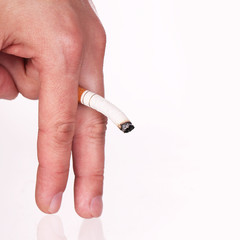 Cigarette in hand symbolizing impotence, isolated