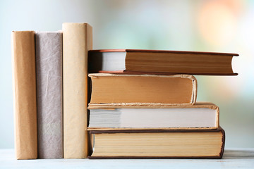 Stack of books on blurred bright background