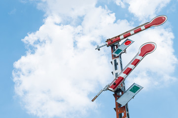 Railroad signal poles on sky