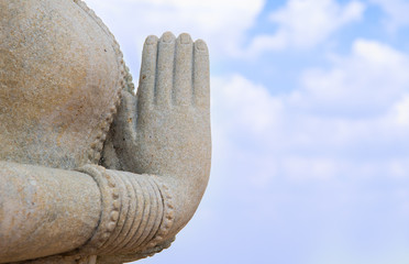 Statue with hands clasped on sky
