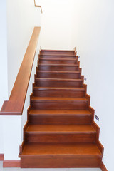 Interior wooden staircase of new house