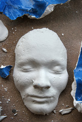 Plaster face mask on the floor