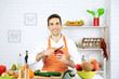 Man at table with different products and utensil in kitchen