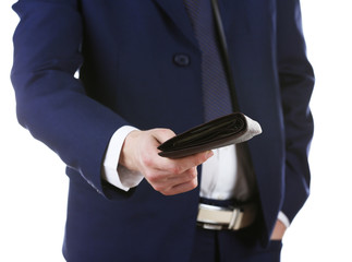 Leather wallet with money in male hands isolated