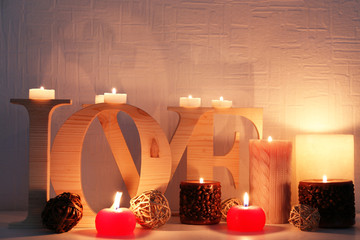 Romantic still life with word LOVE and candle lights