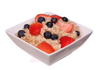 Oatmeal with berries isolated on white