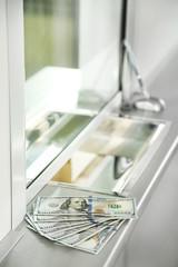 Money on surface near cash department window
