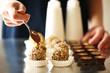 Leinwanddruck Bild - Preparation handmade chocolate candies, close up