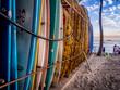 Leinwanddruck Bild - Colourful surfboards stacked up on Waikiki Beach at sunset.