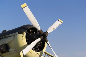 White airplane propeller with four blades