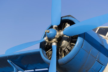 Blue airplane propeller with four blades