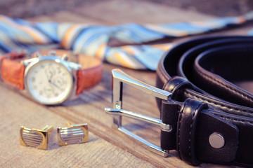 Leather belt, tie, cufflinks and watches