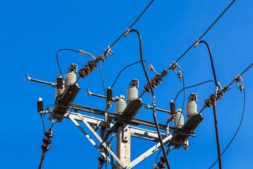 electricity power concrete pole on blue sky background