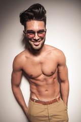 Smiling young casual man posing shirtless