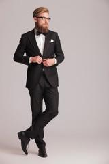 handsome elegant man closing his jacket.
