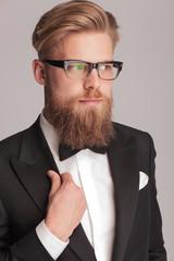 handsome blonde man wearing a tuxedo
