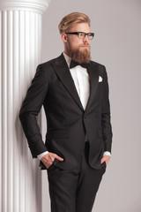 elegant young man wearing a tuxedo