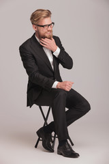 Elegant business man sitting on a stool
