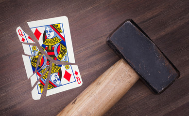 Hammer with a broken card, queen of diamonds