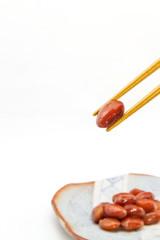 Red kidney bean held by chopsticks Japan