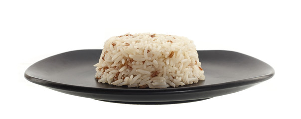 Dish of rice on white