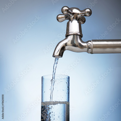 water is poured into a glass from the tap - 78620058