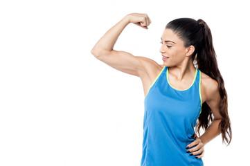 Sporty woman flexing her biceps