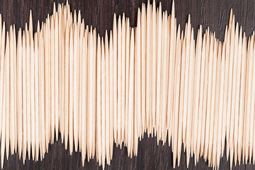 Group of small bamboo toothpicks on vintage background