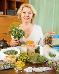 mature woman  with dried herbs in home