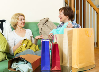 women  talking about purchases