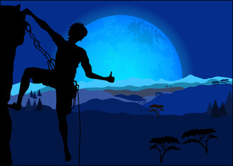 Silhouette of climber showing thumb up against the night mountai