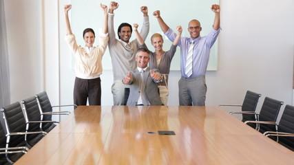 Business team raising arms