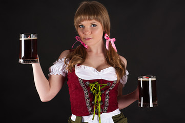 woman Oktoberfest with beer in hand isolated on black