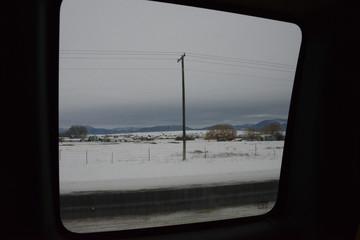 Snowy landscape viewed from car window