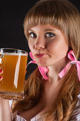 portrait beautiful sad woman Oktoberfest drinks beer
