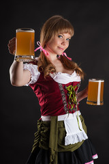 blond woman with Oktoberfest beer in hand